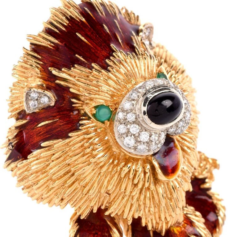 This aesthetically vivacious estate Italian brooch rendered in 18-karat textured yellow gold simulates a stylized version of a handsome dog, with a pair of round emeralds simulating the animal's eyes, an oval cabochon black onyx, surrounded by pave