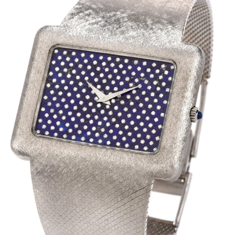 Adorn your wrist with this remarkable Vintage Corum Diamond Lapis Chrome Watch.  This 1970s stylist extra large watch is crafted in 18k white gold with soft silky finish.   The dial is genyine lapis set with  genuine diamonds, round cut, bezel set