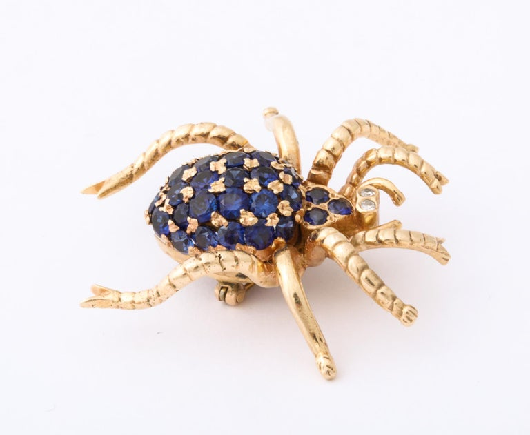 One Ladies 14kt Yellow Gold Figural Spider Brooch Embellished With 30 Beautiful Color Faceted Sapphires Weighing Approximately 1.50 Cts Total Weight. Spider Brooch Is Further Designed With Two Diamond Eyes Weighing Approximately .10 Pts Total
