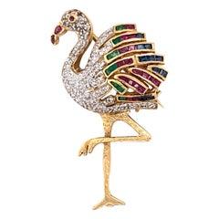 1970s Flamingo Pin featuring Ruby, Sapphire, Emerald in 18 Karat Yellow Gold