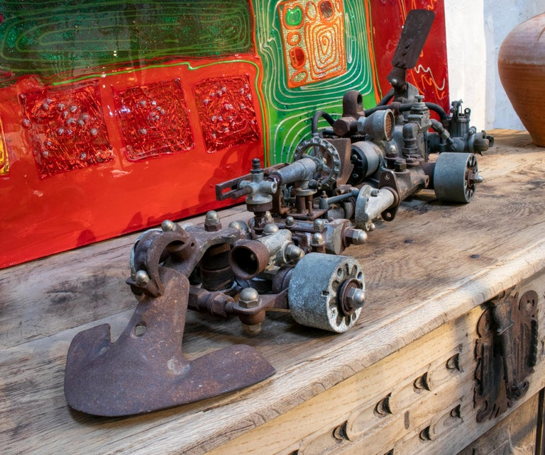 1970s Formula 1 car sculpture made with assorted old mechanical metal pieces: cars, bikes, lawnmowers, etc.