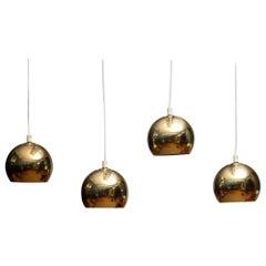 1970s, Four Brass Spherical or Globe Shape Swedish Pendants