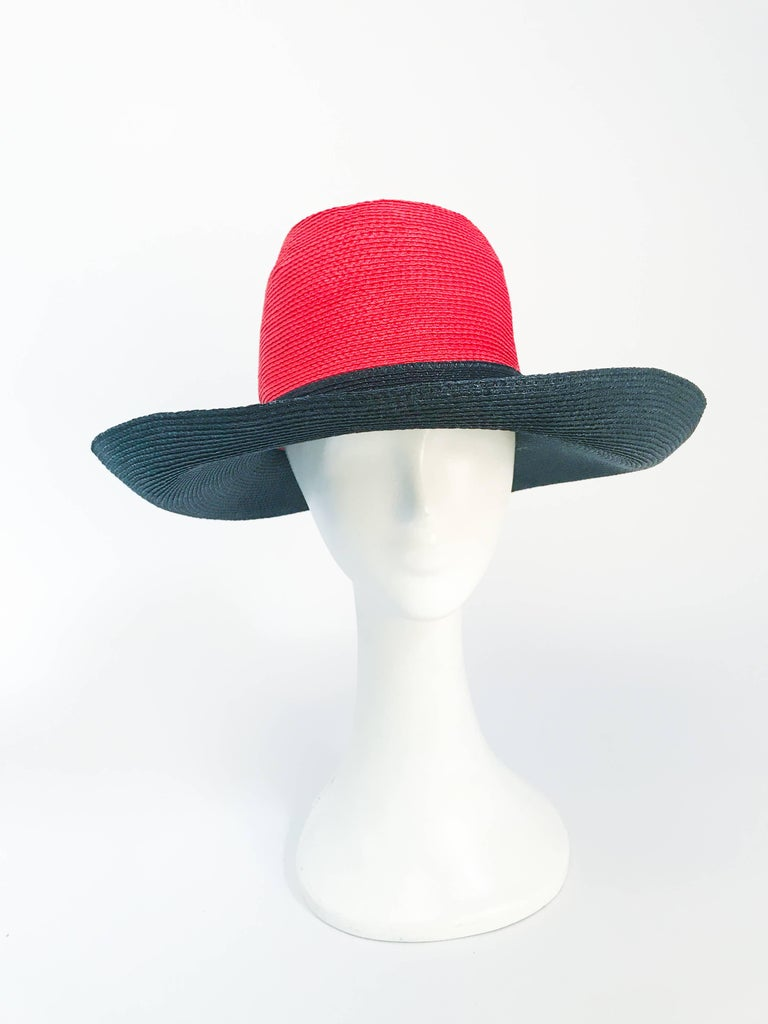 1970s Frank Olive Red and Black Wide-Brimmed Hat. Medium Size. Red and black woven wide-brimmed hat with a thin black hat band. Medium sized.