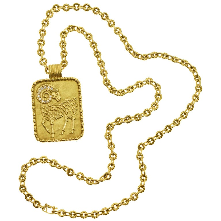 Fred Paris diamond and gold Aries zodiac pendant on a gold chain, 1970s, offered by Mahnaz Collection