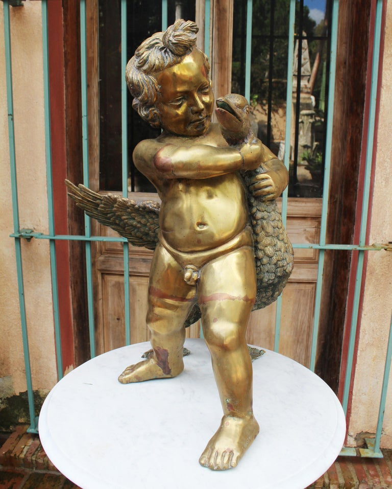 1970s French bronze fountain sculpture of cherub with duck, with water spout on its beak.