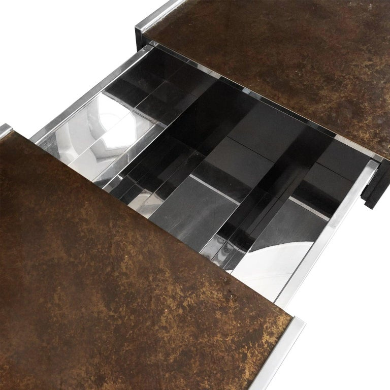 Rectangular chrome and antiqued brown glass coffee table with concealed bar storage, France, 1970s.
