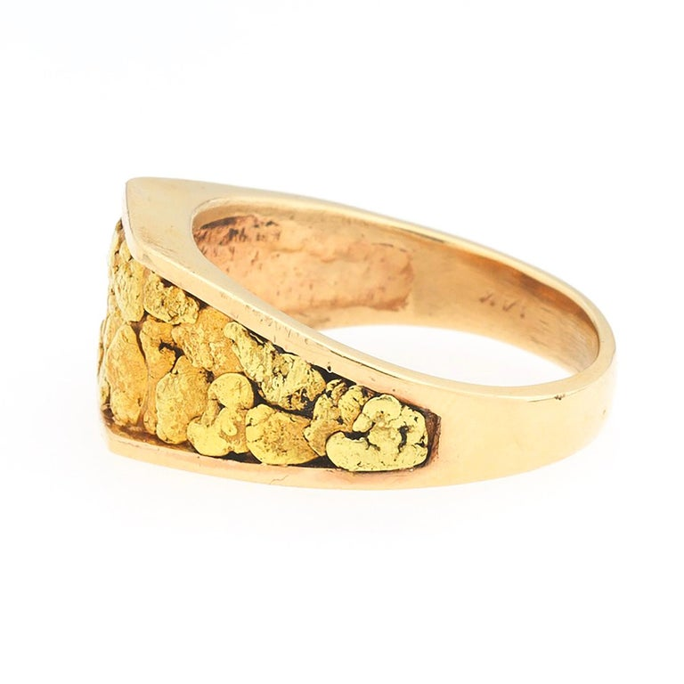 A custom made 14K rose gold ring set with yellow gold nugget texture in the center, circa 1970's. Suitable as an alternative to a wedding ring or otherwise.  Ring is finger size 11 3/4 and can be easily resized by a jeweler of your choice if need
