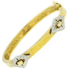 1970s Geometric Diamond Shaped Diamond and 14 Karat Yellow Gold Bangle Bracelet