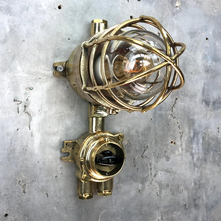 A vintage Industrial solid cast bronze and brass explosion proof pendant manufactured circa 1975 by Wiska and Centurion who are manufacturers of Ex. (explosion proof) rated fixtures.   The lamp comes fitted with a cast brass Wiska isolator