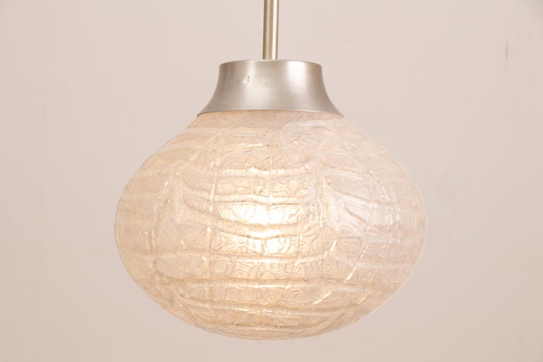 1970s bulbous, crackle, frosted, glass, pendant, hanging-light manufactured by Doria Leuchten, Germany. The glass globe is suspended from a polished chrome fixture and black wire flex which can be adjusted to your specific height requirements. A