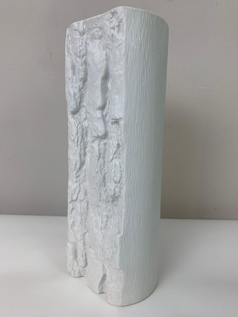 1970s Op Art West Germany white matt bisque rectangular porcelain vase with a bark relief design on the front and back with contrasting smooth lined sides. Designed by Ernst Fenzi. Manufactured in Bareuther Waldsassen, Bavaria, West
