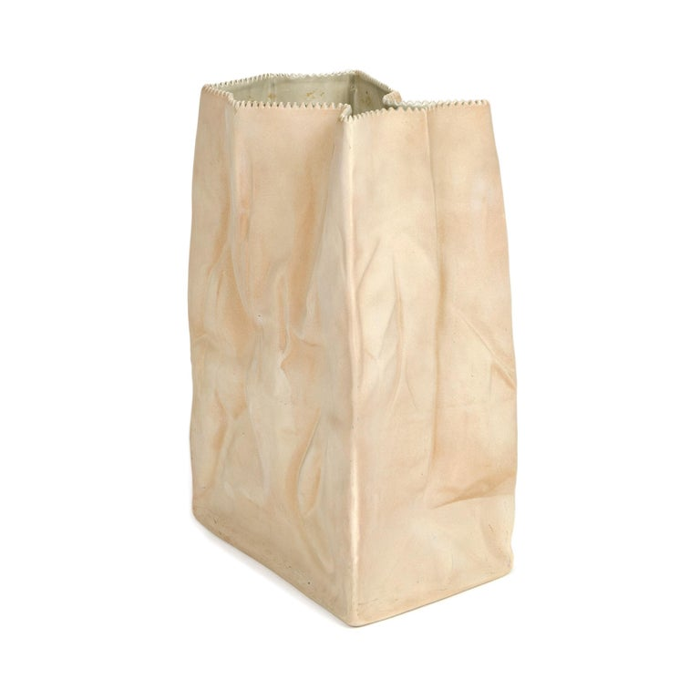 Paper or plastic or…Wirkkala's fun and whimsical 1977 Pop Art take on tromp l'oeil, something that is not what it appears to be. Here, a used paper bag is actually a porcelain vase. Kraft paper brown with a serrated top edge, this bag vase is the