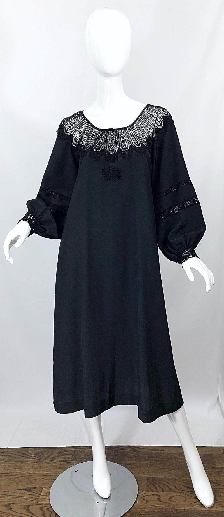 Chic 70s GIORGIO DI SANT ANGELO black crochet bishop sleeve smock dress! Features cut-out crochet detail at neck and mid arm. Adjustable ties at center front neck. Simply slips over the head. Great belted or alone. The pictured vintage Paloma