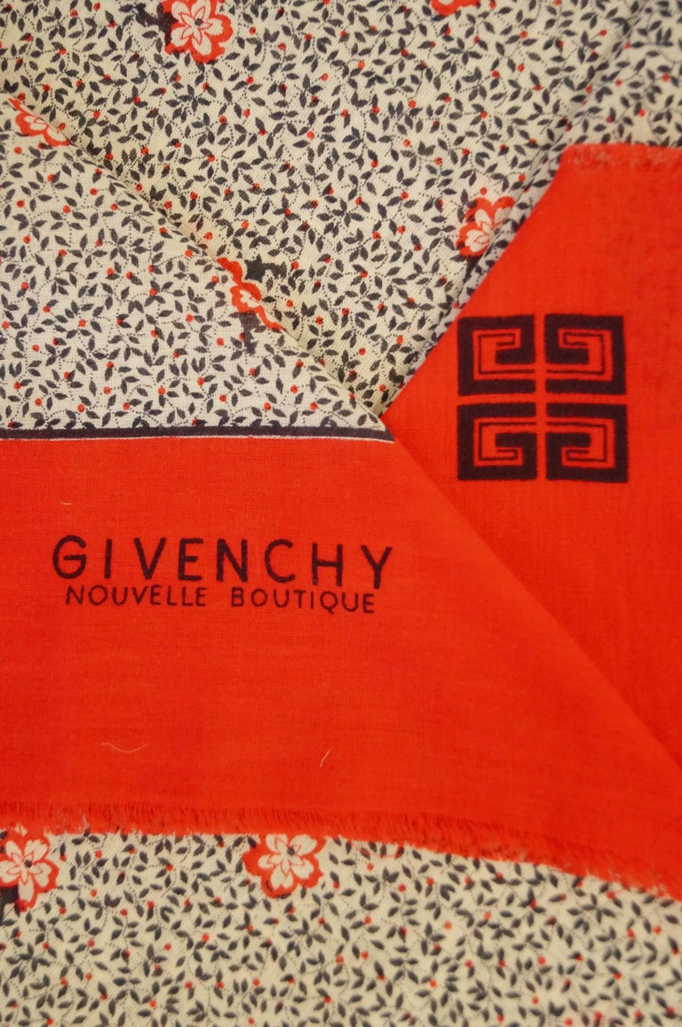 Breezy cotton floral motif midi skirt and shawl by Hubert de Givenchy. The shawl is square with a bright, bold red hem, short fringe, and features the Givenchy logo as well as the