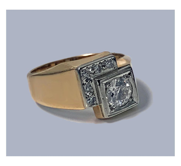 1970's 18K 14K Diamond Ring. The Ring off square set with old european cut diamond, approximately 0.65 ct, SI clarity, I colour, surround mount following the contour se with six single cut diamonds, total weight approximately 0.03 ct, VS clarity, I