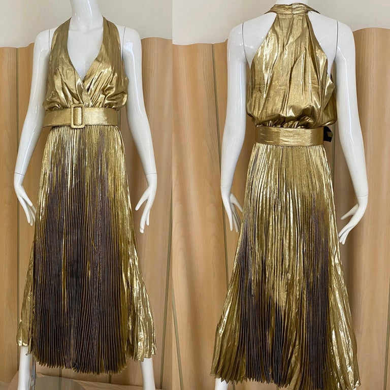 """Vintage 70s gold lame halter V neck sleeveless pleated dress with elastic waist and belt. Bust: 36/ Waist stretch to 32"""". Perfect for studio 54 party  Fit size small to medium  ** flaws: see belt"""
