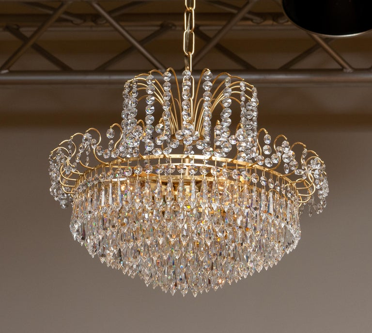 Neoclassical Revival 1970s, Gold-Plated and Faceted Crystal Chandelier Attributed to Rejmyre, Sweden For Sale