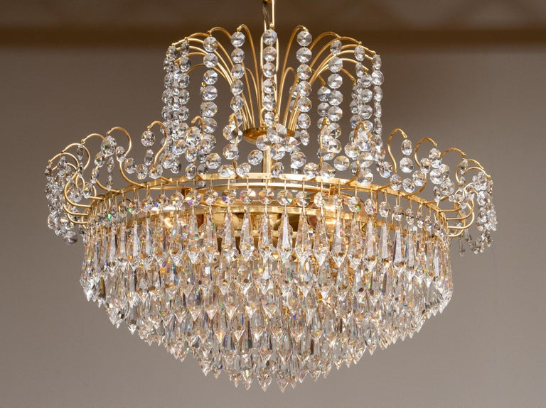 Late 20th Century 1970s, Gold-Plated and Faceted Crystal Chandelier Attributed to Rejmyre, Sweden For Sale
