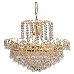 1970s, Gold-Plated and Faceted Crystal Chandelier Attributed to Rejmyre Sweden