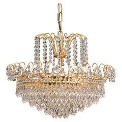 1970s, Gold-Plated and Faceted Crystal Chandelier Attributed to Rejmyre, Sweden