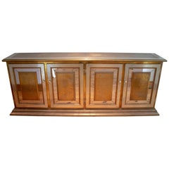1970s Gony Nava Four-Door Gilt Brass and Mirror Console with Eight Drawers