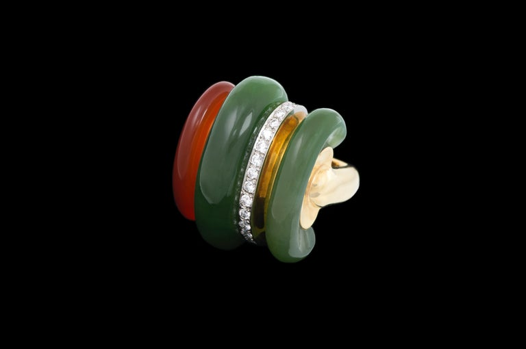 A carnelian, nephrite, diamond stripe, and 18 karat gold ring, by the Swiss firm of Gubelin, c. 1970. This unique and striking ring is a size 5 3/4.