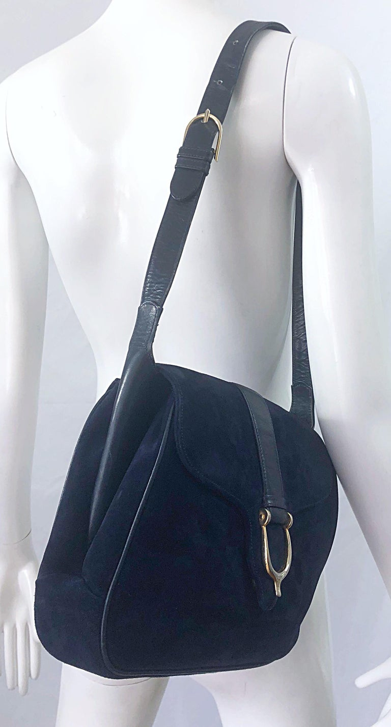 Insanely chic and classic large 1970s GUCCI navy blue suede and leather shoulder bag ! Features the prettiest navy blue suede with leather accents. 'Wings' on each side of the bag can be pulled out to make the bag even larger ( see photos ). Snap