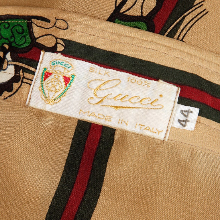 Rare 1970s vintage Gucci blouse with an equestrian-inspired print which features a saddle and the iconic red and green Gucci stripe. From the estate of Pamela Lewis (Jerry Lewis/ Gary Lewis). Covered buttons with metallic