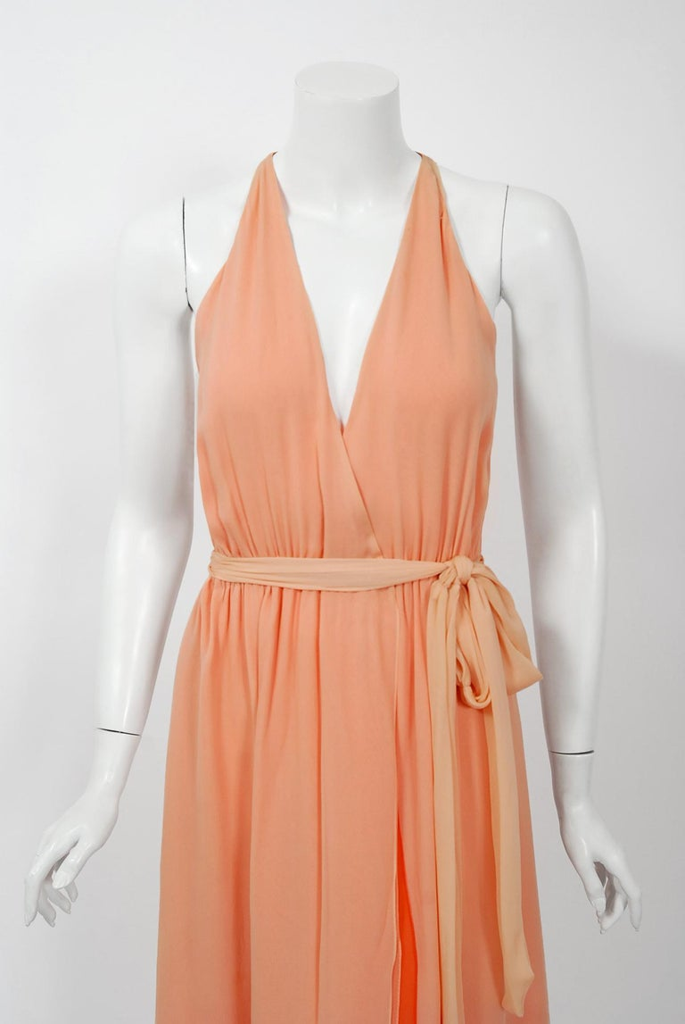 Gorgeous Halston Couture peach ombre wrap dress dating back to the mid 1970's. Halston revolutionized the way women dress and is one of the few designers, alongside Claire McCardell and Norman Norell, to define what is American fashion. Throughout