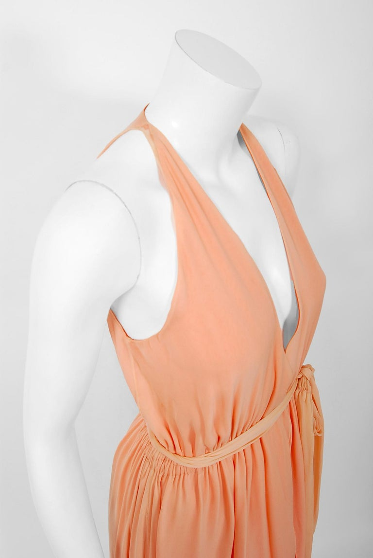1970's Halston Couture Peach Silk-Chiffon Low Plunge Belted Sash Wrap Dress In Good Condition For Sale In Beverly Hills, CA