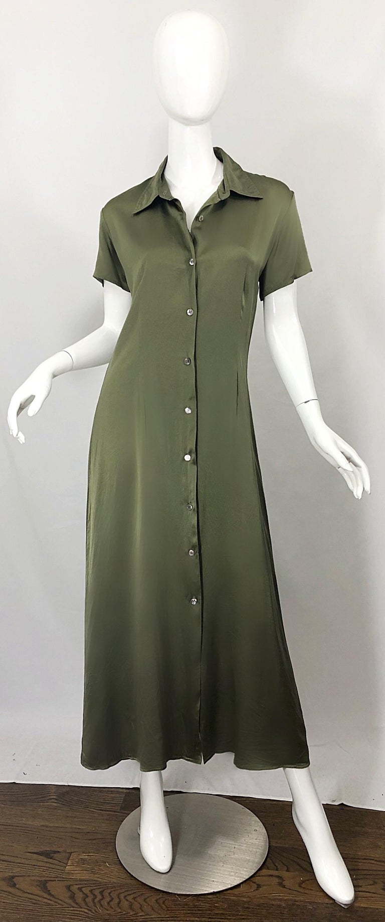Effortlessly chic late 70s HALSTON olive green liquid silk maxi shirt dress! Features a tailored bodice with a forgiving flirty skirt Buttons up the front, and drapes the body beautifully. Can easily be dressed up or down, and is perfect for either