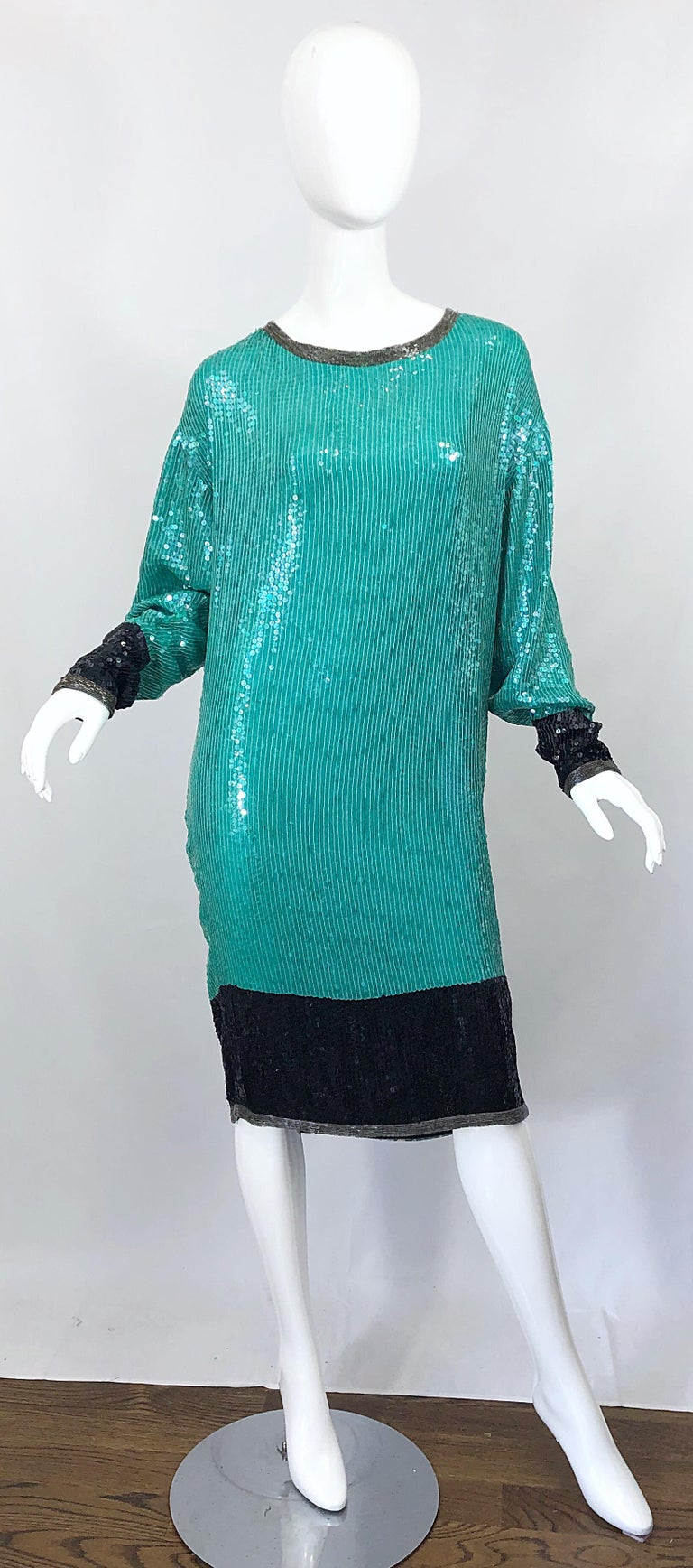 Amazing vintage late 70s HALSTON teal blue/green and black silk sequined and beaded dolman sleeve dress! Features multiple layers of the finest silk chiffon with thousands of hand-sewn sequins and beads throughout the entire dress. Black sequined