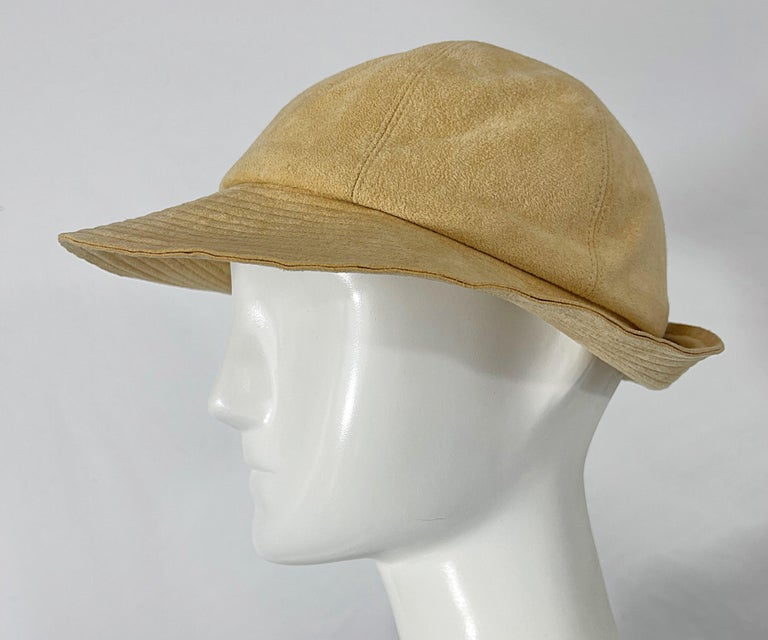 Chic 1970s HALSTON ultra suede tan fedora hat ! Features the soft versatile ultra suede Halston was known for. Can easily be washed in the washing machine ( on cold water and gentle cycle ). Pair this beauty with jeans or a dress.  In great
