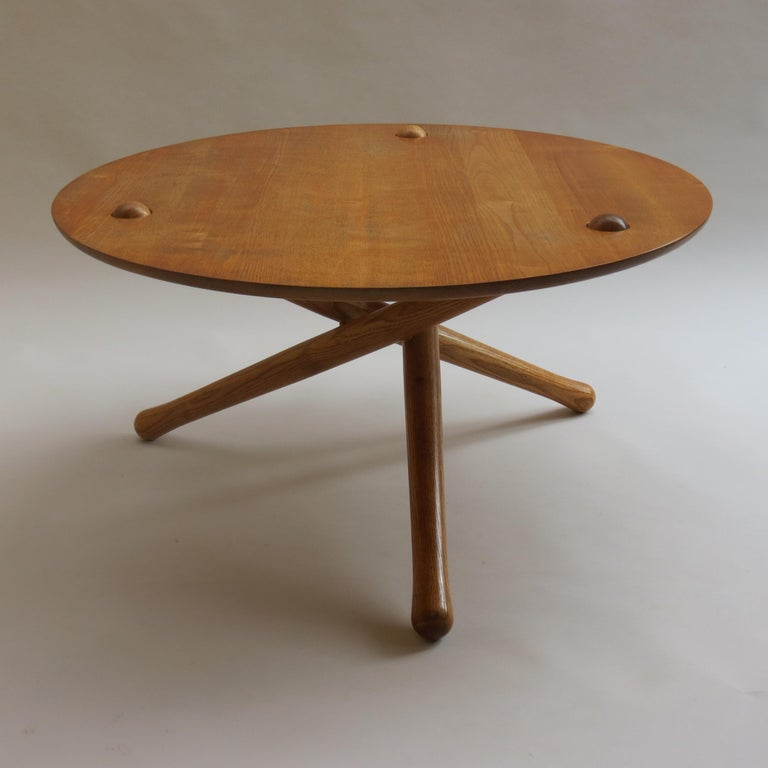 A very well made, good quality coffee table. Solid ash legs and solid ash top. Very cleverly designed and constructed, comprises three connecting legs and solid ash top with circular cutout, the top of the legs to locate in the top of the table this