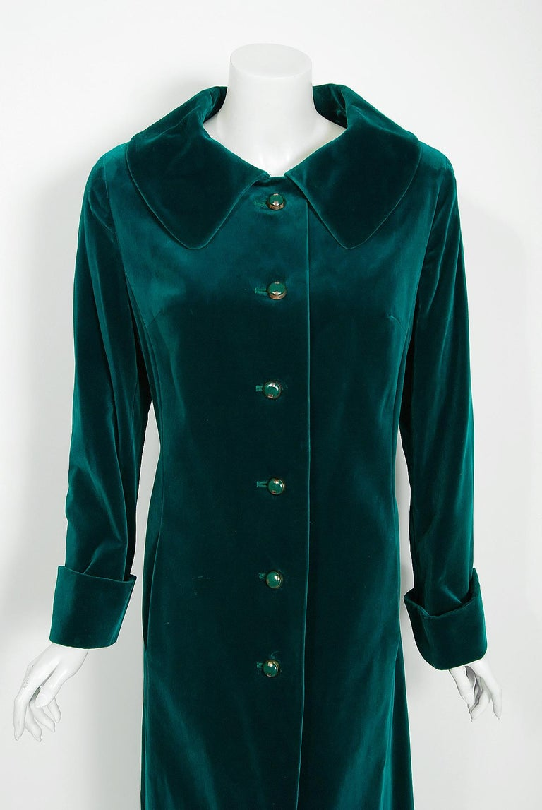This ultra-chic early 1970's Harella of England maxi coat will make any woman shine during cold months ahead. The fabric itself is gorgeous; vibrant teal blue-green midweight cotton-velvet. I love the matching brass buttons and long, lean cuffed