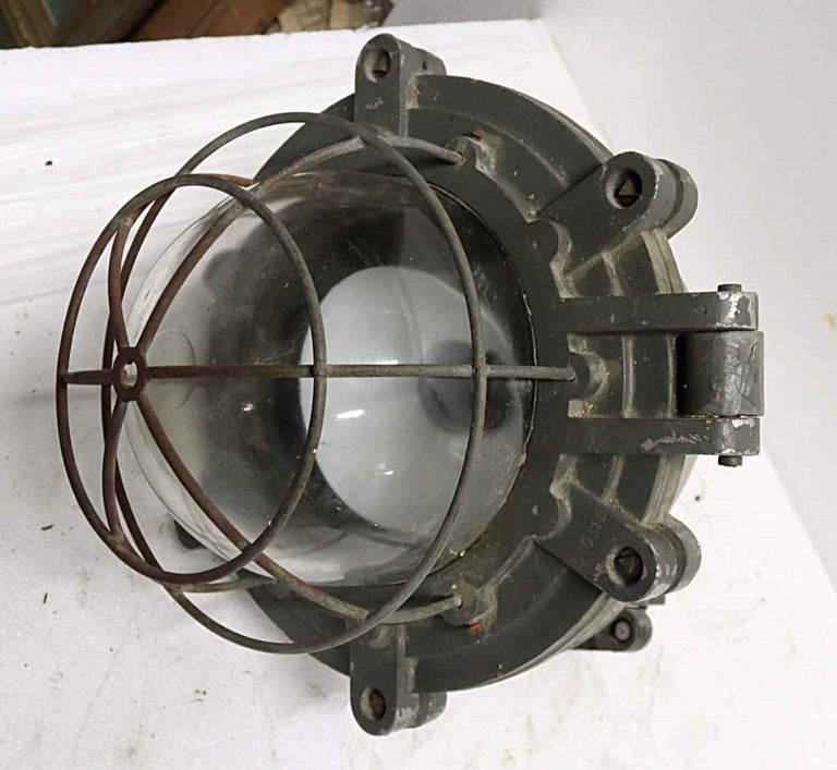 Late 20th Century 1970s Heavy Cast Aluminum Industrial Pendant Light with Cage Cover from Europe For Sale