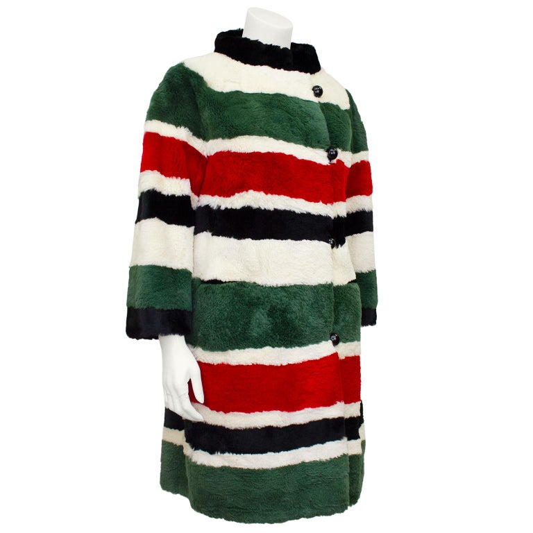 Stunning one-of-a-kind cream, red, green and black sheared beaver mini coat from I Magnin Fur Salon. Dating from 1970's, perfect for someone looking for an excellent condition whimsical winter coat. Raised collar, stunning oversized black resin ball