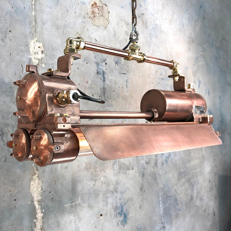 Reclaimed vintage Industrial Korean flameproof striplight made by Daeyang in the 1970s with copper veneer finishing and adjustable suspension bar.   Original item salvaged from supertankers and military vessels then professionally restored