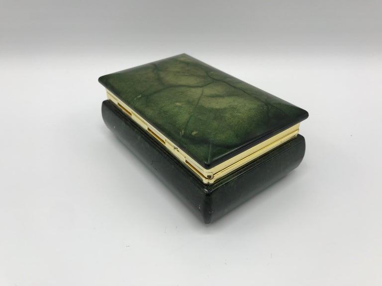 Offered is a stunning and rare, 1970s Italian green alabaster box. The hand carved stone is gorgeous in this rare green tone. It gives off the look of lacquered goatskin or leather. Brass hinge and banding. Marked on underside, 'Made in Italy.'