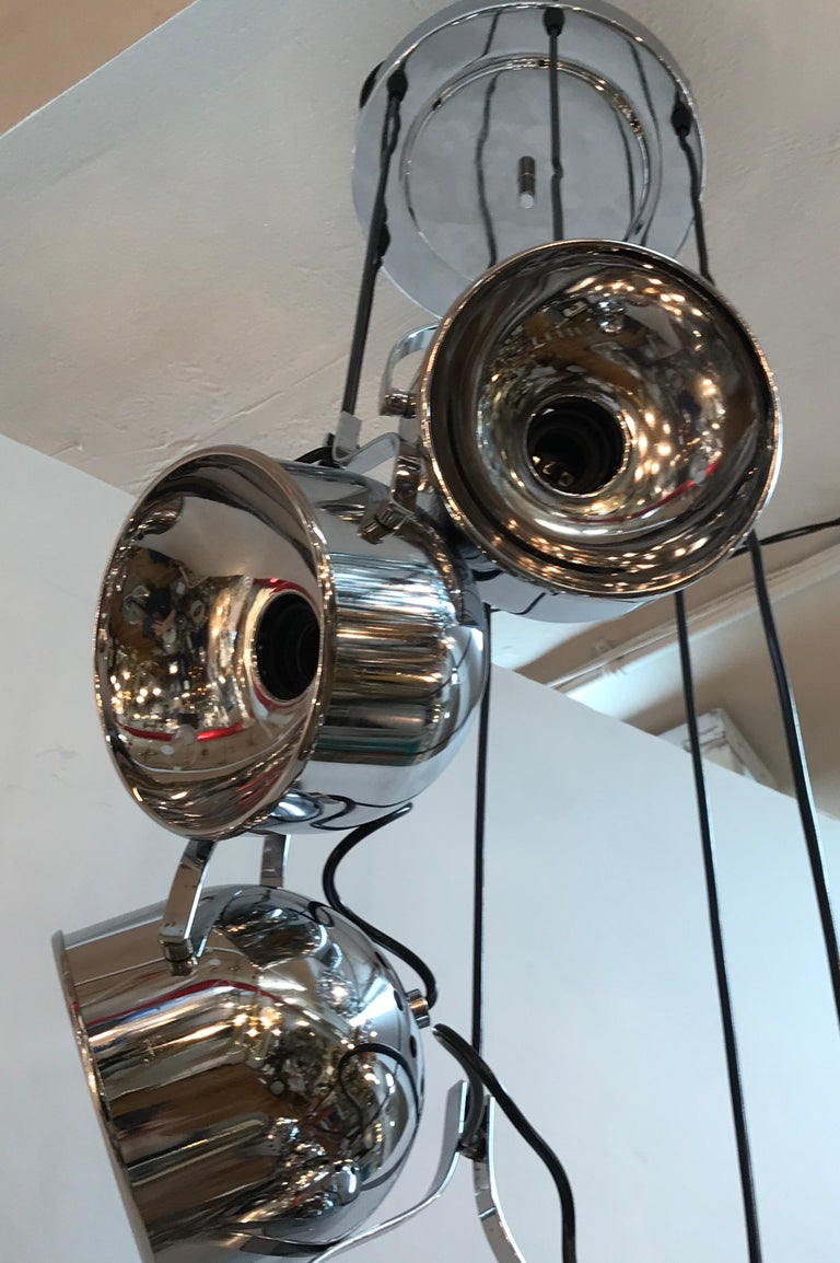 A wonderful architectural and statement piece pendant light fixture from Italy, circa 1970. Each of the six domed canisters may be angled individually and require one standard light bulb. The canisters are suspended from the original matching chrome