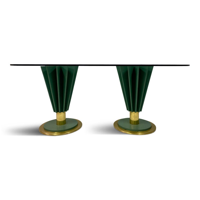 Dining table  By Pierre Cardin  Two painted iron and brass pedestals  Impressed signature  1970s, Italian  Price includes change of glass if required.
