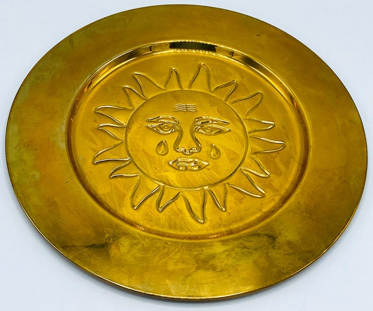 Listed is a fabulous, set of 6, 1970s Italian brass sun charger plates, in the style of Sergio Bustamante. Each plate has an identical, debossed sun motif in the center with a thick rim. Would be perfect for their intended use of chargers, or a