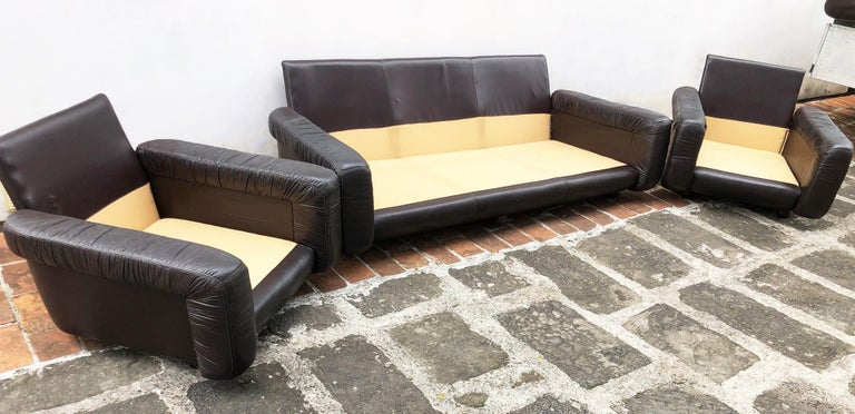 1970s Italian brown leather sofa and armchairs, very comfortable and deep. Particular design Coming from a seaside villa in Castiglion Della Pescaia Dimensions of the armchair: 98 D x 94 W x 76 H Sofa dimensions: 98 D x 215 W x 76 H.