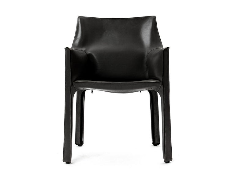 An Italian Mid-Century Modern armchair designed by Mario Bellini featuring handstitched black leather upholstery wrapped over internal steel frame. Manufactured by Cassina in Italy, circa 1977.