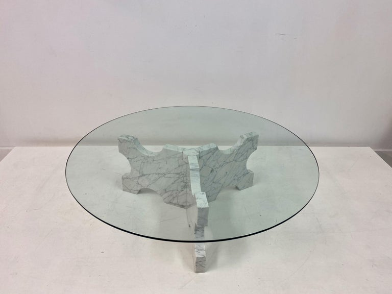 Carrara marble coffee table  Shaped base  Glass top  Italy 1970s.