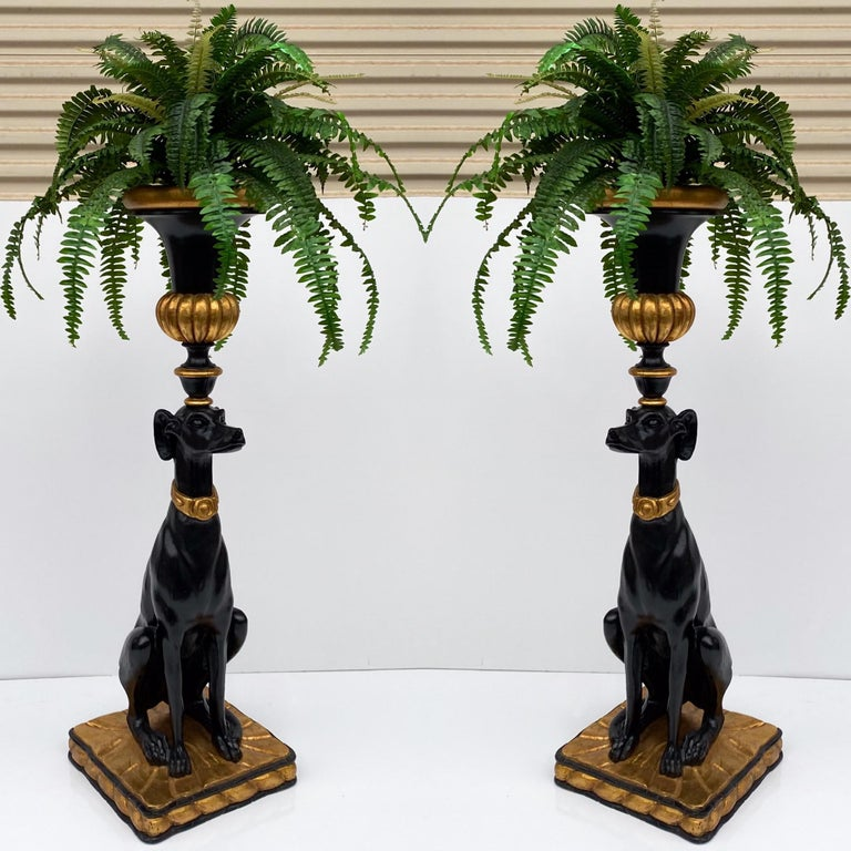 This is a pair of gilt and black lacquer Italian Hollywood Regency style seated greyhounds. They have carved wood removable planters, but the bodies are cast resin. The planter is removable. They are unmarked and in very good condition.
