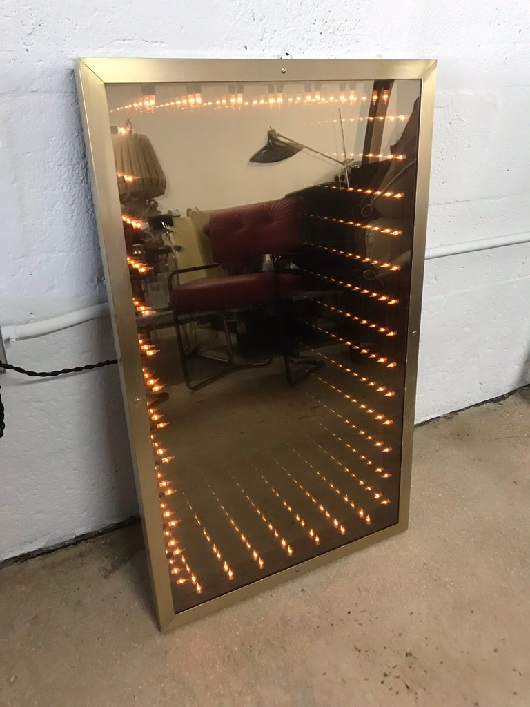 Brass framed infinity mirror, Italy.