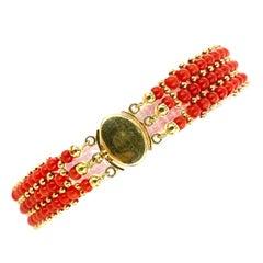 1970's Italian Red Coral Three Row 18 Karat Yellow Gold Vintage Bead Bracelet