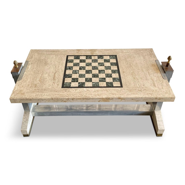 Travertine and chrome games table  Brass and bronze details  Marble inserts  Rotating top with chess on one side and backgammon on the other  Finial locks table in place  Excellent quality  1970s, Italian.