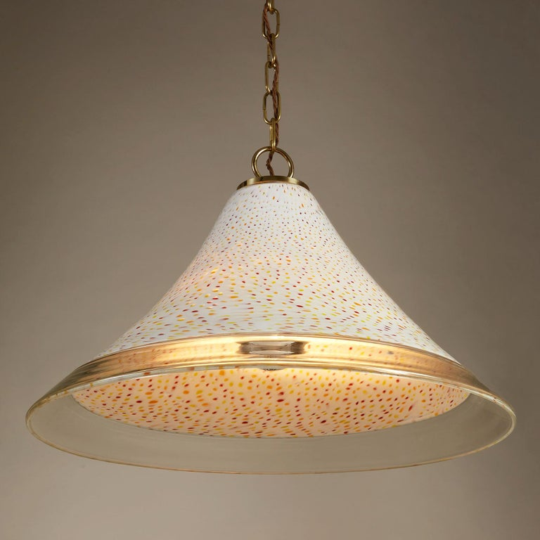 Murano glass conical shade dramatically speckled in red, orange and yellow over a smooth white ground – contemporary brass fittings.   Two available  Re-wired and PAT tested.  Measures: 33cm drop (excl. chain) x 52cm diameter. each.